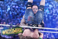 Hustle Photo Book: The Undertaker Takes Out John Cena at WrestleMania 34